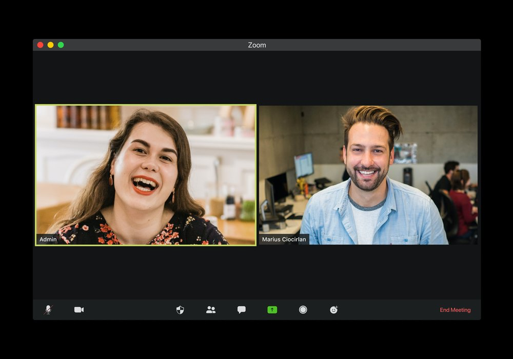 Two people have a video conference meeting