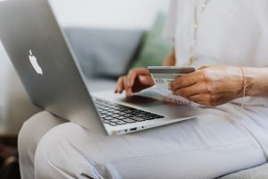 woman making a credit card payment on her computer
